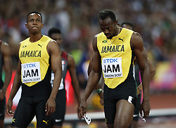 LONDON, Aug. 13, 2017  Usain Bolt (R) of Jamaica leaves the track with his teammates after he failed to finish the Men's 4x100m Relay Final on Day 9 of the 2017 IAAF World Championships at London Stadium in London, Britain, on Aug. 12, 2017. (Credit Image: © Han Yan/Xinhua via ZUMA Wire)