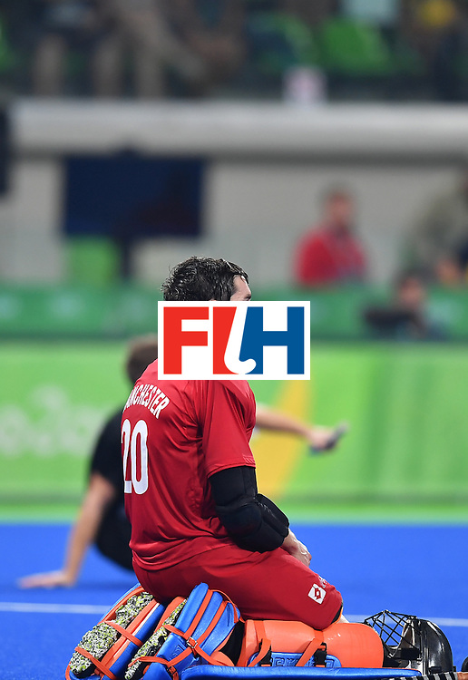 New Zealand's Devon Manchester kneels on the pitch at the end of the men's quarterfinal field hockey Germany vs New Zealand match of the Rio 2016 Olympics Games at the Olympic Hockey Centre in Rio de Janeiro on August 14, 2016. / AFP / MANAN VATSYAYANA        (Photo credit should read MANAN VATSYAYANA/AFP/Getty Images)
