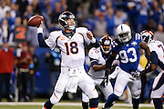 Denver Broncos quarterback Peyton Manning (18) throws the ball during the NFL week 7 football game against the Indianapolis Colts on Sunday, Oct. 20, 2013, at Lucas Oil Stadium in Indianapolis, Indiana. The Colts won the game 39-33. (Joe Robbins)