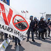 """VENICE, ITALY - JUNE 06:  Police block the entry to the touristinc port to the march of  the """"No Grandi Navi""""  movement (No Big Ships) on June 6, 2014 in Venice, Italy. Todays protest was to highlight one again the problem of the big cruise ships in Venice and the major works as the MOSE, TAV or Expo 2015.  (Photo by Marco Secchi/Getty Images)"""