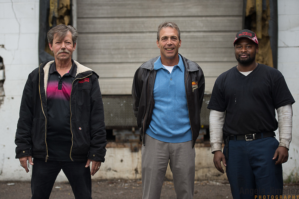 Tim Hoag, center, owner of Copeland Trucking, pictured here at the company's location in Fridley, Minnesota on October 2, 2014, recently hired driver Bill McMahon, left, who lives in California, due to a driver shortage. At right is mechanic intern Tony Code of Minneapolis, another recent hire. <br /> <br /> [ Angela Jimenez/Special to the Star-Tribune  angelajime@gmail.com Assignment #20036493A_ SLUG: TRUCK100514_ EXTRA INFORMATION: Minnesota's severe trucker shortage is forcing wages up and creating accommodating working conditions for drivers. That means shorter trips and less time away from family. In Bill McMahon's case, he and Copeland co-owner Tim Hoag struck a deal: McMahon will get to haul a load to his home in California at least once a month, an exception the company made due to the driver shortage.