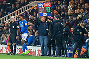 The volunteer 4th official holds up the sub board  during the EFL Sky Bet League 1 match between Peterborough United and Rotherham United at London Road, Peterborough, England on 25 January 2020.