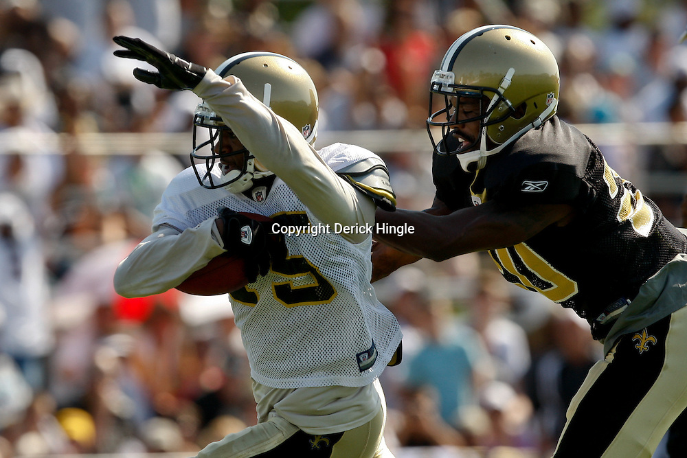 July 31, 2010; Metairie, LA, USA; New Orleans Saints wide receiver Courtney Roby (15) runs past cornerback Randall Gay (20) during a training camp practice at the New Orleans Saints practice facility. Mandatory Credit: Derick E. Hingle