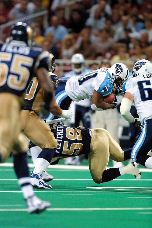 Linebacker London Fletcher (59) of the St. Louis Rams tackles running back Mike Green (20) in a 23 to 10 loss to the Tennessee Titans on 08/17/2001. . ©Wesley Hitt/NFL Photos