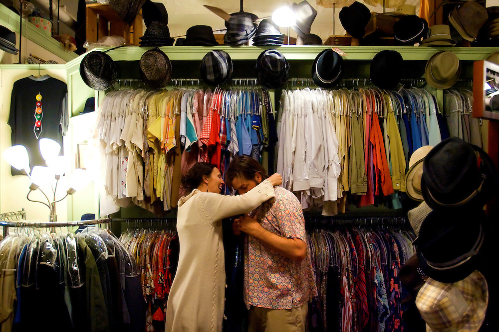 YBOR CITY, FL -- March 6, 2010 -- Courtney Murr helps her husband, Doug, both of St. Augustine, Fla., try on a vintage shirt at La France in Ybor City near Tampa, Fla., on Saturday, March 6, 2010.  Tampa and the surrounding area has become a hub for vintage clothing, furniture, and trinkets.