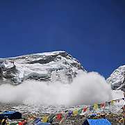 A massive avalanche rains down across the Khumbu Icefall on Mount Everest, Nepal, on May 7, 2009. The second such avalanche in one week, this one killed Lhapka Nuru Sherpa.<br />
