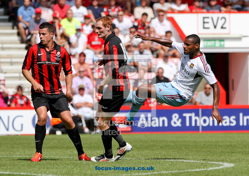 Picture by Tom Smith/Focus Images Ltd 07545141164<br /> 13/07/2013<br /> Ricardo Vaz Te (right) of West Ham United in the air after taking a shot during the Stephen Purches testimonial pre season friendly match at the Seward Stadium, Bournemouth.