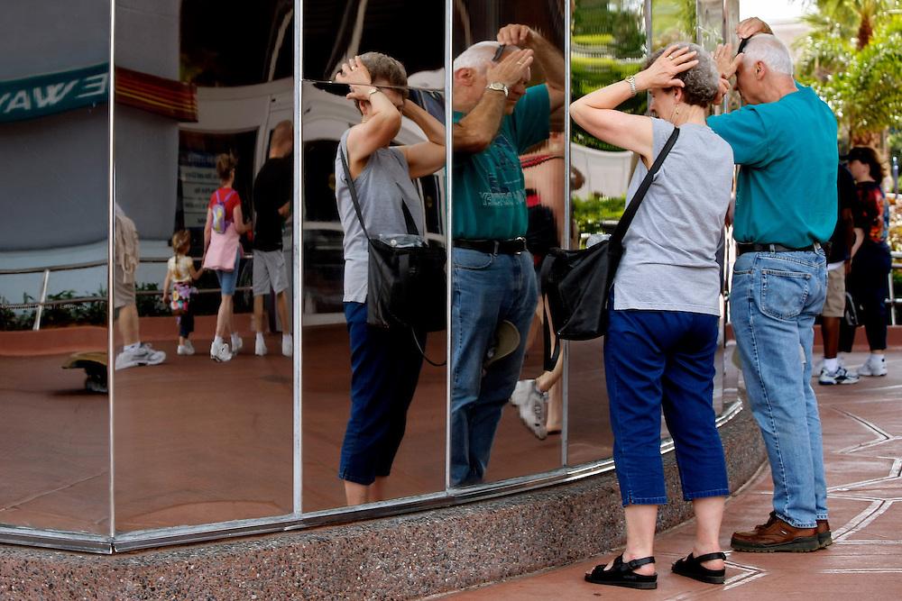 Orlando, Florida, USA, 20090325:   The Disney EPCOT Center in Orlando. The futuristic architecture makes for a good mirror for hair adjustment. Photo: Orjan F. Ellingvag/ Dagbladet/ Corbis