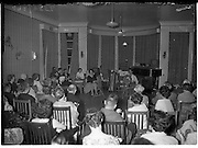 27/06/1959<br /> 06/27/1959<br /> 27 June 1959<br /> Gael Linn Cabaret at Bundoran. Two of the artistes, Fionnuala O'Sulleabhain, (left) and Aine Nic Cana, R.E. Singer, singing Amhrain Saothair in a traditional manner.