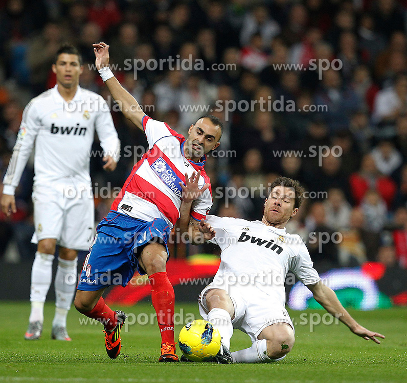 07.01.2012, Santiago Bernabeu Stadion, Madrid, ESP, Primera Division, Real Madrid vs FC Granada, 18. Spieltag, im Bild Real Madrid's Xabi Alonso and Granada's CF Carlos Martins during the football match of spanish 'primera divison' league, 18th round, between Real Madrid and FC Granada at Santiago Bernabeu stadium, Madrid, Spain on 2012/01/07. EXPA Pictures © 2012, PhotoCredit: EXPA/ Alterphotos/ Cesar Cebolla..***** ATTENTION - OUT OF ESP and SUI *****