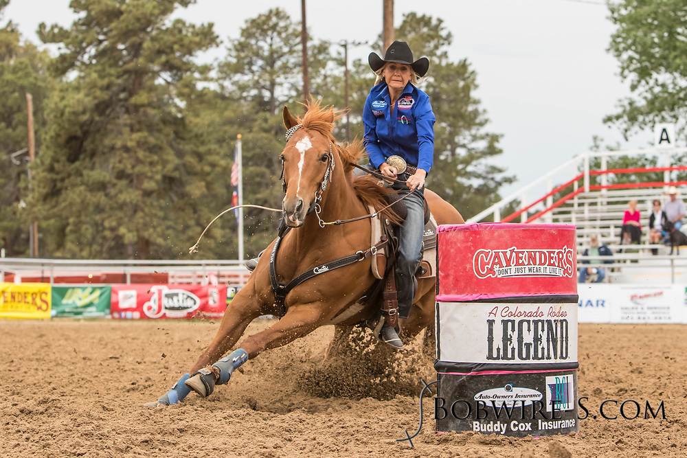 Christine Laughlin makes her barrel racing run during slack at the Elizabeth Stampede on Sunday, June 3, 2018.