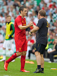 DUBLIN, REPUBLIC OF IRELAND - Saturday, August 10, 2013: Liverpool's Stewart Downing shakes hands with manager Brendan Rodgers after being substituted against Glasgow Celtic during a preseason friendly match at the Aviva Stadium. (Pic by David Rawcliffe/Propaganda)
