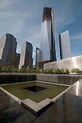 New York City Freedom Towers and the reflecting pools at GroundZero Saturday may12,2012.  © Suzi Altman.
