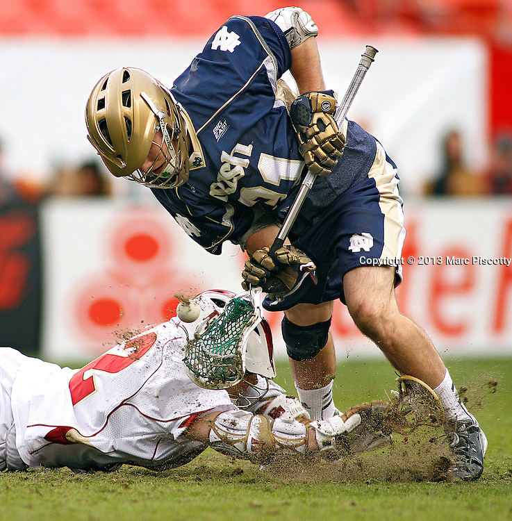 SHOT 3/16/13 5:11:52 PM - Notre Dame's Liam O'Connor #31 battles for the ball during a face off against Denver's Chase Carraro #32 during their college lacrosse game at the Whitman's Sampler Mile High Classic at Sports Authority Field at Mile High in Denver, Co. on Saturday March 16, 2013. Notre Dame won the game 13-12 in overtime. (Photo by Marc Piscotty / © 2013)