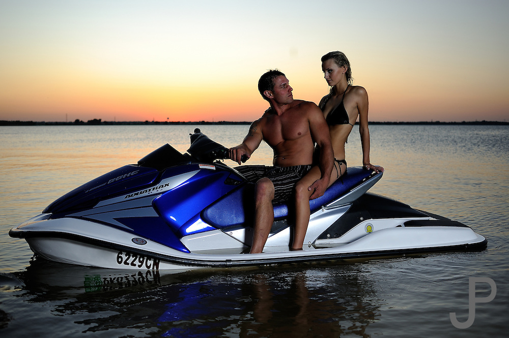 Joey Freeland and Emily Cochran on Honda Aquatrax R-12 at sunset on Overholser Lake. Model released