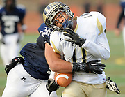 Middletown: Class LL football semifinals between Ansonia and Hyde. Ansonia's Andrew Matos tackles Elijah Nixon stopping Nixon's drive during the 3rd quarter.  Mara Lavitt/New Haven Register<br /> <br /> 12/02/12