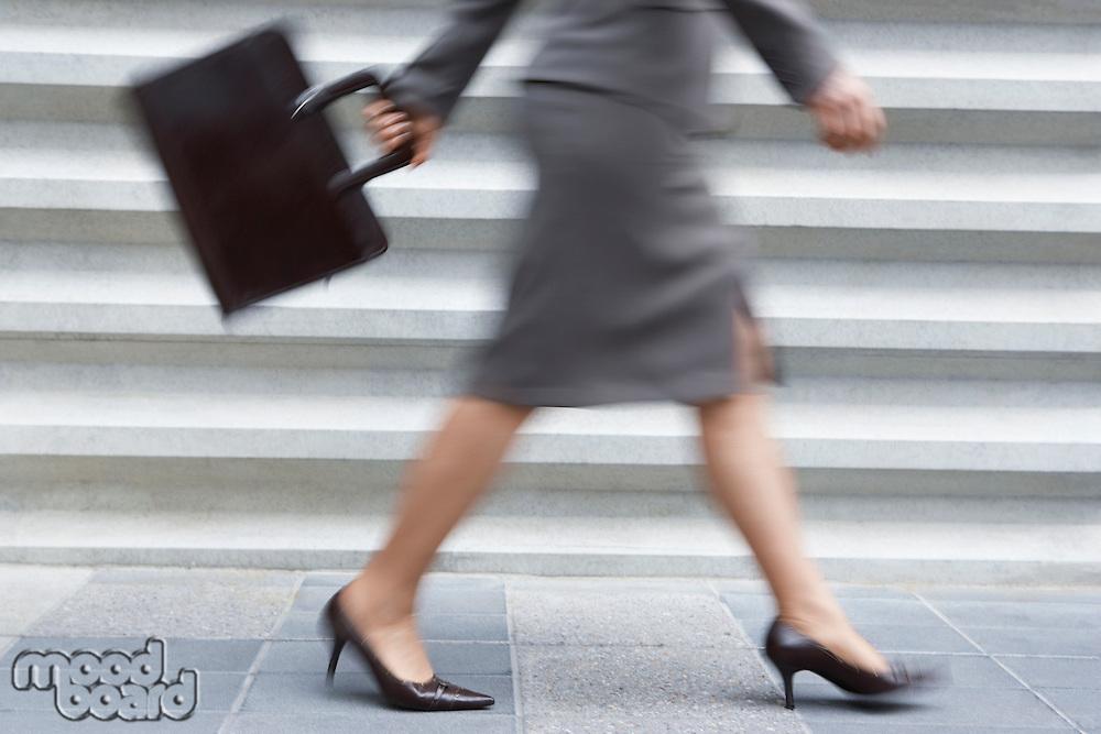Businesswoman Walking Fast