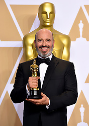 Mark Bridges with his Best costume design (Phantom Thread) Oscar in the press room at the 90th Academy Awards held at the Dolby Theatre in Hollywood, Los Angeles, USA.Photo credit should read: Matt Crossick/EMPICS Entertainment