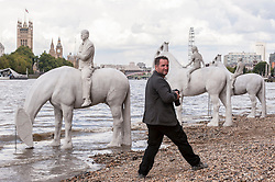 "© Licensed to London News Pictures. 02/09/2015 London, UK. The art installation entitled ""The Rising Tide"" (comprising four horse-riders on horses with petroleum pumps for heads) by the underwater eco-sculptor Jason deCaires Taylor (pictured), which stands on the foreshore of the River Thames in Vauxhall and is revealed with each low tide.  The installation aims to question man's reliance on fossil fuels and is part of this year's Totally Thames festival. Photo credit : Stephen Chung/LNP"