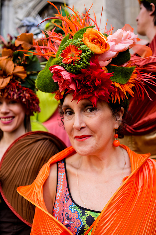 New York, NY - April 16, 2017. Multimedia designer Jodie Trapani wears a hat of her own design at New York's annual Easter Bonnet Parade and Festival on Fifth Avenue. She is part of a group calling themselves The City Chicks, all of whom wore hats designed by Trapani and wraps designed by Alexandra Tsoukala.