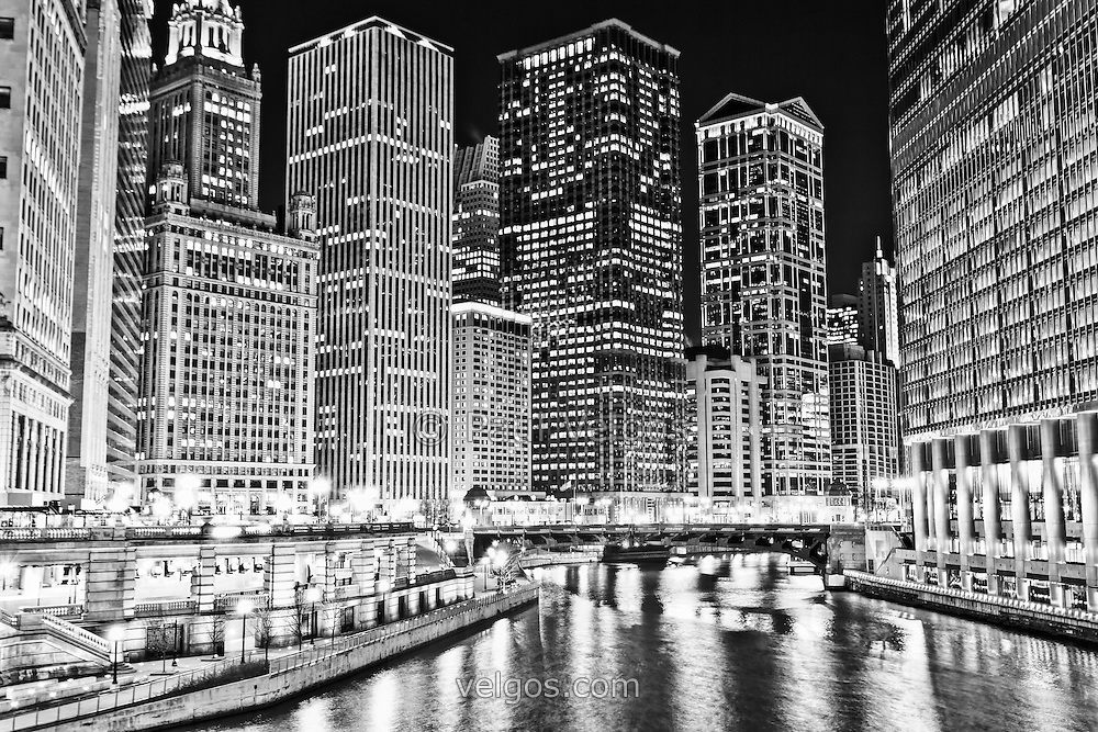 Chicago River skyline at night black and white picture with Wabash Avenue Bridge (Irv Kupcinet Bridge) and downtown city buildings.