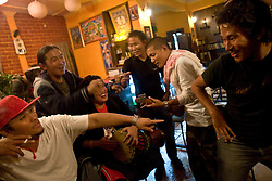 INDIA - Life in Exile (Tibetan Refugees) Young Tibetans party at a cafe in McLeod Ganj, Dharamsala, India, where the Dalai Lama settled after fleeing Tibet in 1959 after a failed uprising against Chinese rule, May 30, 2009.