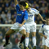 Rangers v St Johnstone....03.12.03<br />Ross Forsyth in aerial tussle with Michael Mols<br /><br />Picture by Graeme Hart.<br />Copyright Perthshire Picture Agency<br />Tel: 01738 623350  Mobile: 07990 594431