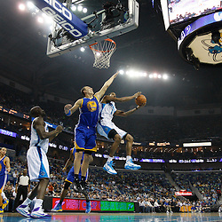January 5, 2011; New Orleans, LA, USA; New Orleans Hornets small forward Trevor Ariza (1) shoots over Golden State Warriors center Andris Biedrins (15)during the first quarter at the New Orleans Arena.   Mandatory Credit: Derick E. Hingle