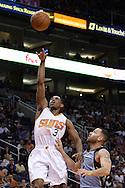 Mar 21, 2016; Phoenix, AZ, USA; Phoenix Suns guard Brandon Knight (3) shoots the ball in front of Memphis Grizzlies guard Jordan Farmar (4) in the first half at Talking Stick Resort Arena. Mandatory Credit: Jennifer Stewart-USA TODAY Sports