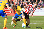Alan Power and Asa Hall during the Vanarama National League match between Cheltenham Town and Lincoln City at Whaddon Road, Cheltenham, England on 30 April 2016. Photo by Antony Thompson.