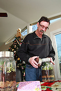 Jerry Woodbury with terrariums he made in an art class, photographed at home in Kettering, Saturday, December 22, 2012.