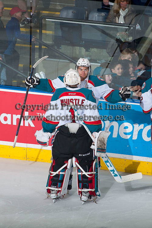 KELOWNA, CANADA - MARCH 27:  Madison Bowey #4 congratulates Jackson Whistle #1 of Kelowna Rockets on the shut out the win against the Tri-City Americans on March 27, 2015 at Prospera Place in Kelowna, British Columbia, Canada.  (Photo by Marissa Baecker/Shoot the Breeze)  *** Local Caption *** Madison Bowey; Jackson Whistle;