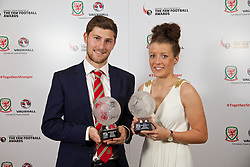 CARDIFF, WALES - Monday, October 6, 2014: Wales' Men's and Women's Young Players of the Year 2014 Ben Davies and Angharad James with their trophies at the FAW Footballer of the Year Awards 2014 held at the St. David's Hotel. (Pic by David Rawcliffe/Propaganda)
