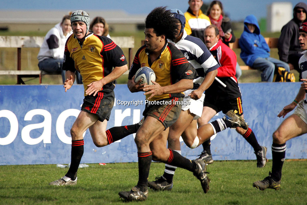 Thames Valley flanker Filo Tuuga on the attack during the match between Thames Valley and the Auckland Divisional XV in Thames, 1st August 2004.<br />Auckland beat Valley 20 - 17.<br />Please credit: PHOTOSPORT