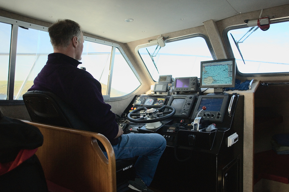 Angus Campbell at the helm of the Orca, setting out for day trip to St. Kilda