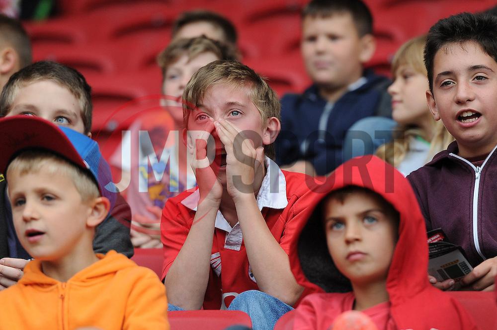 A young Bristol City fan looks on - Mandatory byline: Dougie Allward/JMP - 07966 386802 - 03/10/2015 - FOOTBALL - Ashton Gate - Bristol, England - Bristol City v MK Dons - Sky Bet Championship