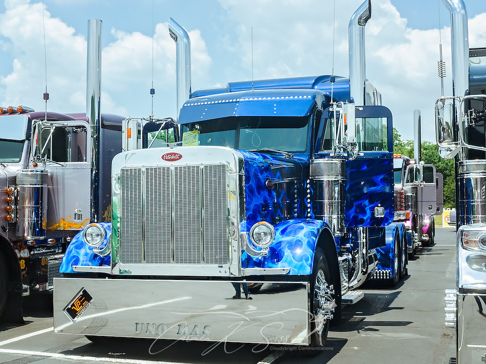 """Suzanne Rodriquez's """"Uno Mas,"""" a 1999 Peterbilt 379 extended hood, waits to be judged at the 34th annual Shell Rotella SuperRigs truck beauty contest, June 11, 2016, in Joplin, Missouri. SuperRigs, organized by Shell Oil Company, is an annual beauty contest for working trucks. Approximately 89 trucks entered this year's competition. """"Uno Mas"""" won best theme. (Photo by Carmen K. Sisson/Cloudybright)"""