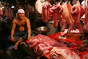 A butcher and pork at the Divisoria market, Manila, Philippines. (From a photographic gallery of meat and poultry images, in Hungry Planet: What the World Eats, p. 164).