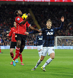 Cardiff City Midfielder, Kevin Theophile Catherine (FRA) battles for the ball with Man Utd Midfielder Adnan Januzaj (BEL) - Photo mandatory by-line: Joseph Meredith/JMP - Tel: Mobile: 07966 386802 - 24/11/2013 - SPORT - FOOTBALL - Cardiff City Stadium - Cardiff City v Manchester United - Barclays Premier League.