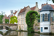 Picturesque traditional scene and tourist boat along Groenerei Canal (Green Canal) in old town Bruges - Brugge - Belgium