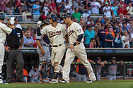 Trevor Plouffe #24 of the Minnesota Twins is congratulated by teammate Justin Morneau #33 after hitting a home run against the Detroit Tigers on June 15, 2013 at Target Field in Minneapolis, Minnesota.  The Twins defeated the Tigers 6 to 3.  Photo: Ben Krause