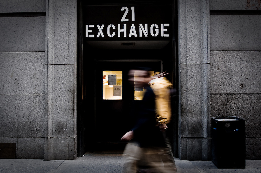 Two men pass by a door to the New York Stock Exchange on October 10, 2008.  Earlier that day, the Dow Jones Industrial Average dropped below 8500, it's lowest level in more than five years.