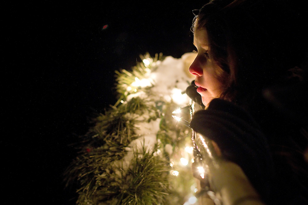 Rheana Pollos, 9, looks at over the waters of Lake Coeur d'Alene during the holiday lights VIP cruise, Tuesday, Nov. 23, 2010.