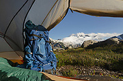 Backcountry camp near Middle Lakes, Mount Challenger and Whatcom Peak seen in the distance through door of tent. North Cascades National Park Washington