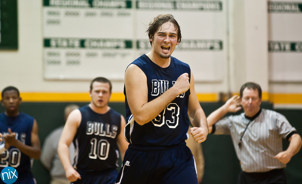 Hickory Ridge's Danny Book reacts as the Ragin' Bulls expand their lead late in the game against Central Cabarrus Tuesday night at Central Cabarrus High School. Hickory Ridge won the South Piedmont Conference matchup 71-65. (Photo by James Nix)