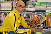 Yisrael Aharoni (born 1953) an Israeli chef and restaurateuran promotes his latest cookbook in a book store