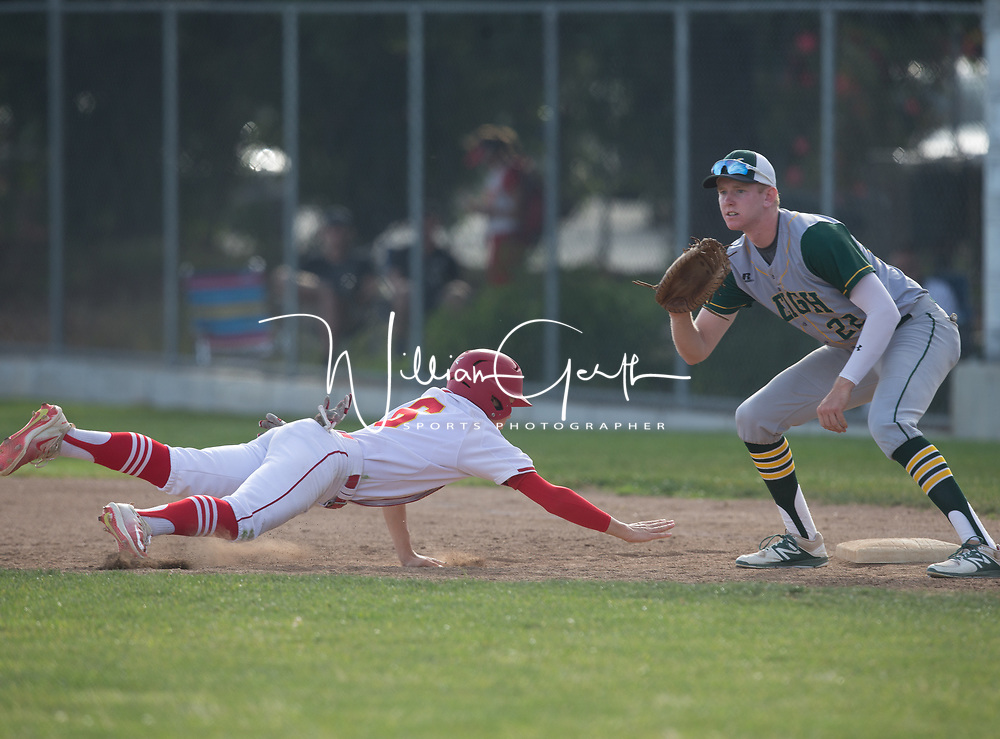 (Photograph by Bill Gerth/for SVCN/5/4/17) Leigh #22 Kyle Johnson awaits the throw as Willow Glen #6 Owen Vannest dives back into first in a BVAL Baseball Game at Willow Glen High School, San Jose CA on 5/4/17 (Willow Glen defeats Leigh 10-1)