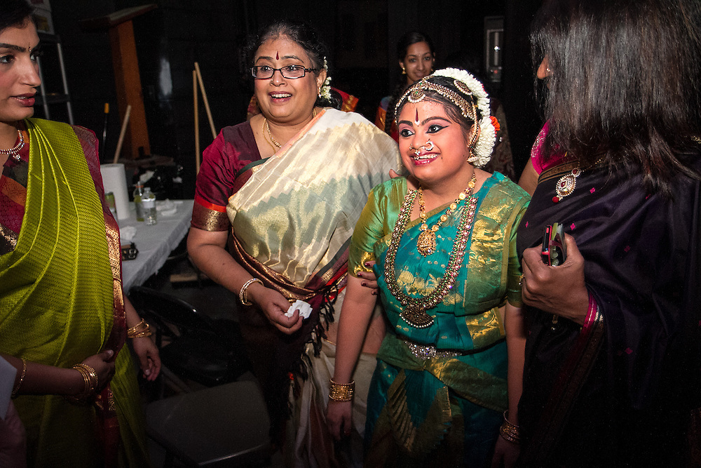 Lincroft, New Jersey, 9/20/14: Hema prepares for a costume change during her arangetram perfomance with her mother Gayathri Ramaswamy (left) and sister Geetha Radhakrishnan (far left).