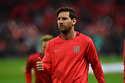 Lionel Messi (10) of Barcelona gives a wink and thumbs up during the warm up before the Champions League match between Tottenham Hotspur and Barcelona at Wembley Stadium, London, England on 3 October 2018.