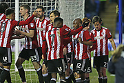 Brentford players celebrate  Brentford Lasse Vibe (21) goal 1-0 second half during the EFL Sky Bet Championship match between Reading and Brentford at the Madejski Stadium, Reading, England on 20 January 2018. Photo by Gary Learmonth.